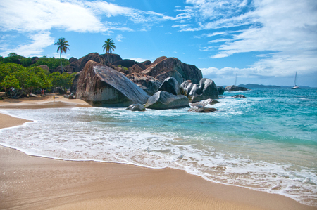 """Attractive \""""the Bath\"""" Beach with Turquoise Sea Water, Granite Boulders and Trees Under Blue and White Sky on a Tropical Climate. Located at the Virgin Gorda Island, Tortola in the Caribbean Stock Photo"""