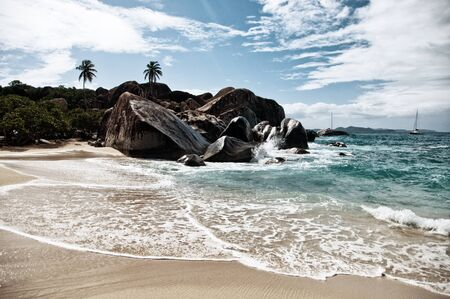 caribbean climate: Attractive the Bath Beach with Turquoise Sea Water, Granite Boulders and Trees Under Blue and White Sky on a Tropical Climate. Located at the Virgin Gorda Island, Tortola in the Caribbean