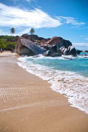caribbean climate: Attractive Beach with Turquoise Sea Water, Granite Boulders and Trees Under Blue and White Sky on a Tropical Climate. Located at the Virgin Gorda Island in the Caribbean Stock Photo
