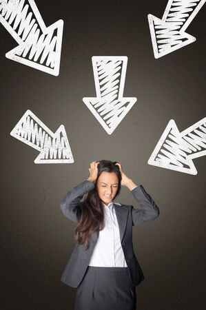 coping: Stressed Young Office Woman with Conceptual White Arrows Above Pointing Her on Abstract Gray Gradient Background. Stock Photo