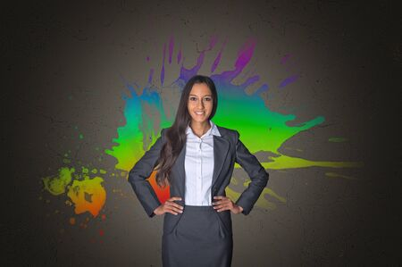 innovator: Confident Young Office Girl in Front a Creative Color Mixture Background on Gray Gradient.