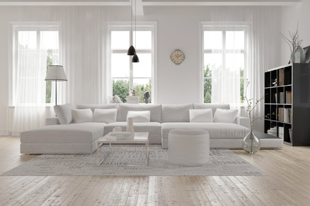 room decoration: Modern spacious lounge or living room interior with monochromatic white furniture and decor below three tall bright windows with a dark bookcase accent in the corner