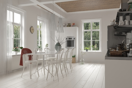 Open-plan spacious white kitchen and dining room interior in a loft with ceiling beams, bright windows and monochromatic white cabinets, table and chairs and wooden floor photo