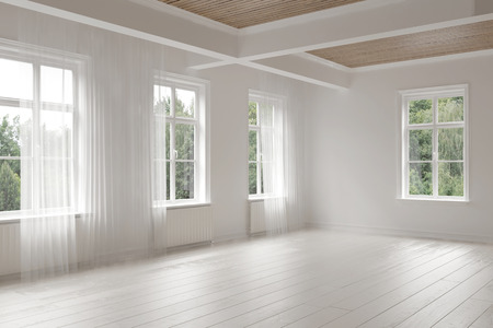 Large empty spacious bright white loft room lit by numerous windows overlooking green trees for your furniture placement