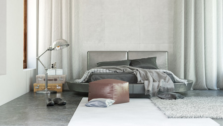 sea bed: Stylish modern bedroom interior with grey decor and rugs thrown over a double bed with ottoman and long drapes on either side