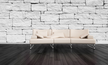 uncarpeted: Stylish settee in a rustic room with a stone brick accented wall and dark hardwood floorboards in a minimalist living room interior Stock Photo