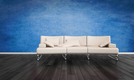 undecorated: Elegant modern white three seater and metal leather sofa in an undecorated room with black wooden flooring and a deep blue textured wall