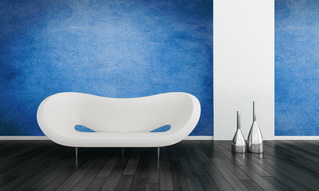 settee: Modern blue living room interior with a contemporary white modular settee and metallic vases on a black hardwood floor with white accents and a blue wall Stock Photo