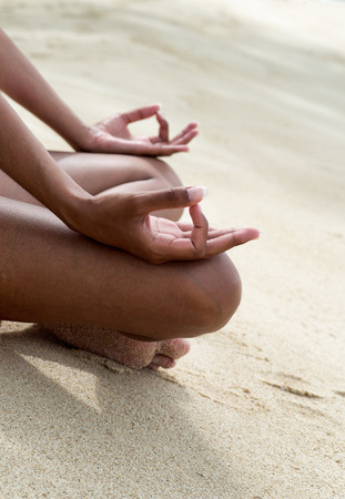indian yoga: Close up Hand Gesture of Indian Doing Female Basic Yoga Activity on White Beach Sand. Stock Photo