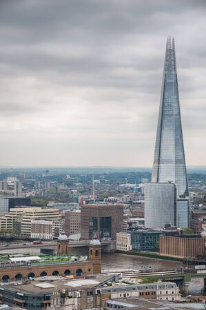 urbanism: External view of the Shard in London on a cloudy day with copyspace in an architectural and travel concept Stock Photo