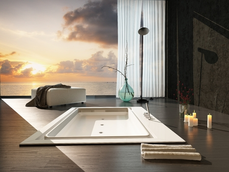 fittings: Romantic modern bathroom interior at sunset with a view of a colorful orange sky through a large view window overlooking a sunken bathtub and burning candles