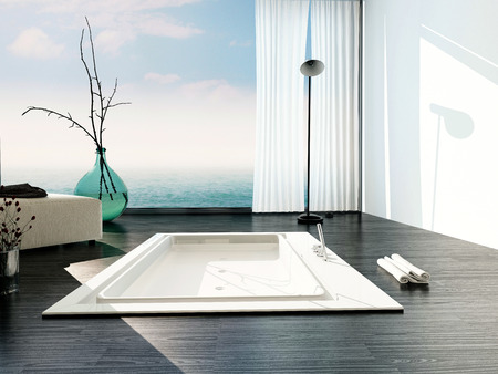 fittings: Stylish sunken bath in a modern bathroom with large floor-to-ceiling glass windows with white blinds and a view of a cloudy blue sky casting sunlight across the parquet floor and bathtub Stock Photo