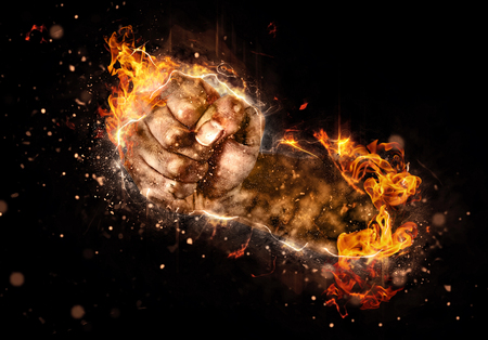Burning fist of fire on black background