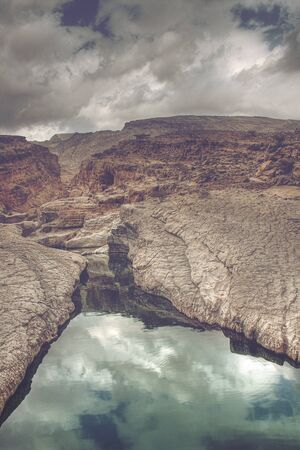 bani: Clouds Reflected in Waters of Wadi Bani Khalid Running Through Rocky Canyon, outside of Muscat, Oman