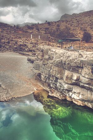 bani: Emerald Green Water of Wadi Bani Khalid in Rocky Landscape Outside of Muscat, Oman Stock Photo