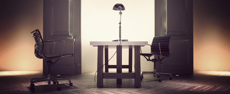centered: Spacious corporate office interior with a desk and chairs centered in front of an alcove flanked with pillar detail on an old herringbone pattern parquet floor Stock Photo