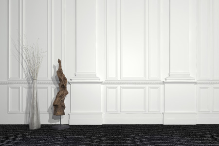 Blend of modern and classic architecture with a contemporary sculpture and floral arrangement standing in front of a paneled white wall with wainscoting and copyspace