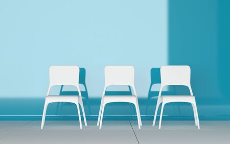 modular home: Three modern modular white chairs standing in a row in a blue room with shadow detail and copyspace