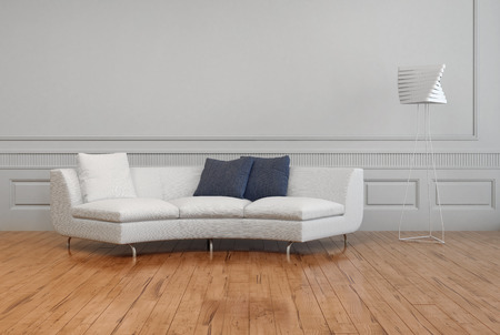 エレガントな白いソファ、白と灰色の枕と白い壁、茶色の木の床と空の部屋に、芸術的なランプ シェード。