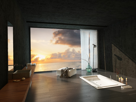 Sunken bathtub in a modern luxury bathroom with a colorful sunset visible through the large window