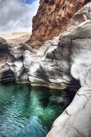 bani: Beautiful Scenic of Green Pool Waters as part of Wadi Bani Khalid in Rocky Landscape Outside of Muscat, Oman