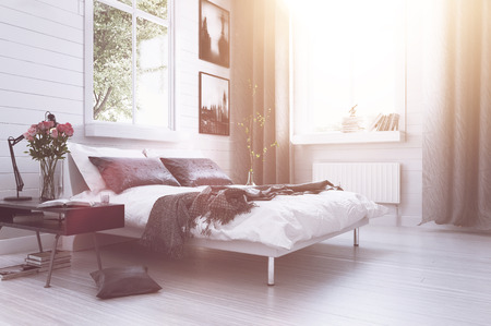 Warm sunlight with sun flare in a modern luxury bedroom with a double divan bed, flowers, artwork on the walls and long drapes in grey and white decor