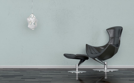 chair wooden: Elegant black recliner chair in a minimalist room standing against a grey-blue wall with a wall-mounted lighting sconce, on a wooden parquet floor Stock Photo
