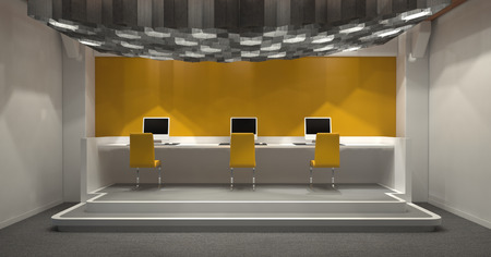down lights: Modern windowless internet cafe with yellow and grey decor and a row of three computer monitors on a raised platform at the end lit by a group of hexagonal down lights. 3d Rendering. Stock Photo