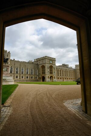 berkshire: View through an archway of the Upper Ward and entrance to the official State Apartments, Windsor Castle, Berkshire, UK