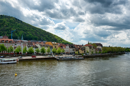 river banks: Neckar River at Heidelberg, Germany with historic buildings lining the river banks in a tourism and travel concept