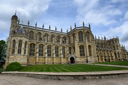 View of the Gothic external facade of St Georges Chapel, Windsor Castle, UK, built in the 15th century and a popular tourist attraction and historical landmark