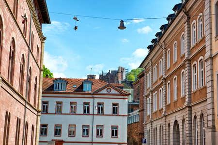 Heidelberg Castle Visible Over Rooftops of Historic Buildings in Heidelberg BadenWurttemberg Germany