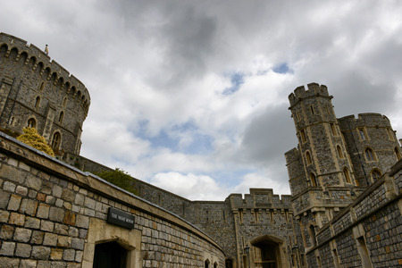 berkshire: Low Angle View of Medieval Windsor Castle Towers Against Cloudy Blue Sky, Berkshire, England Editorial