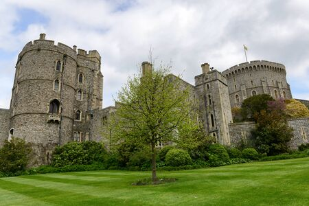 historical landmark: Round Tower viewed from the Lower Ward, Windsor Castle, Berkshire, UK, an official residence of the Queen and historical fortified landmark and popular tourist attraction
