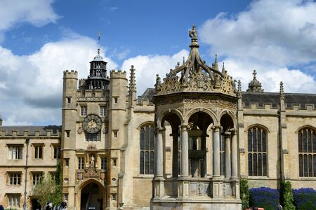 university fountain: Historical architecture of Trinity College,Cambridge University, Cambridge, UK, with the Kings Gate, chapel and detail of the fountain in the foreground