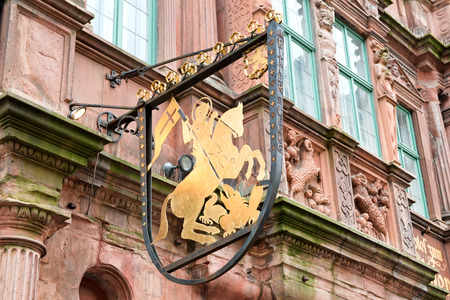 slaying: Detail of Sign Featuring Golden Rider on Horseback on Exterior of Historic Hotel Zum Ritter in Heidelberg, Baden-Wurttemberg, Germany