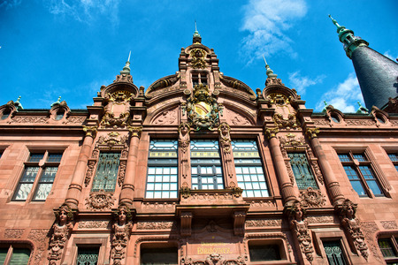 ornately: Low Angle View of Heidelberg University Library, Ornately Decorated Facade Above Entrance Against Blue Sky, Heidelberg, Baden-Wurttemberg, Germany