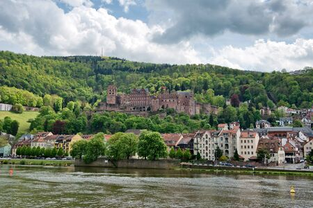 hillsides: View of Heidelberg Castle and Town on the Banks of Neckar River, Surrounded by Lush Forested Hillsides, Heidelberg, Baden-Wurttemberg, Germany Stock Photo