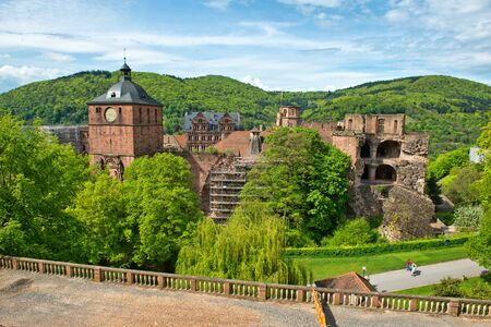 hillsides: View of Crumbling Castle Ruins Nestled in Lush Green Hillsides, Heidelberg, Baden-Wurttemberg, Germany Stock Photo
