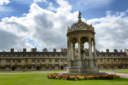 university fountain: Historical stone fountain at Trinity College, Cambridge University, cambridge standing in the middle of neatly manicured green lawns in the Great Court