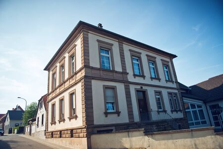 municipality: Historical Building on Street Corner on Bright Sunny Morning in Bissersheim, Rhineland-Palatinate, Germany