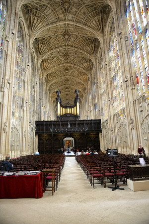rood: Looking Down Aisle Between Empty Rows of Seats in Nave at Kings College Chapel Toward Rood Screen, Organ and Altar, University of Cambridge, England Editorial
