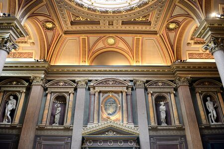 antiquities: Interior of Brightly Lit Gallery Hall Featuring Statue Sculptures in Wall Recesses in Fitzwilliam Museum, Art and Antiquities Museum of University of Cambridge, England