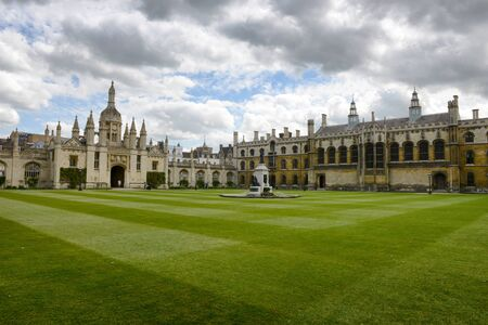 gatehouse: Wide View of Courtyard with Manicured Green Lawn with Kings College Gatehouse on Left, University of Cambridge, England