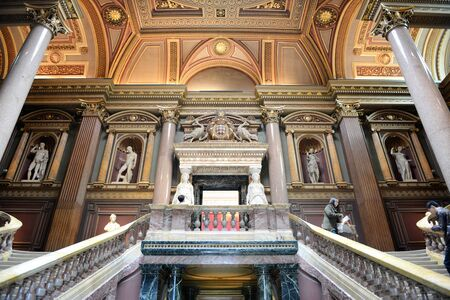 antiquities: Interior staircases at the Fitzwilliam Museum for antiquities and fine art at Cambridge, Engleand with recessed historical sculptures on the wall of the landing