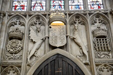 Architectural Interior Detail of Stone Carved Coat of Arms Above Main Door Entrance of Kings College Chapel, University of Cambridge, England Editorial