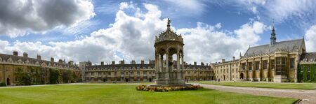 Panoramic of Sun Shining on Great Court with Covered Fountain in Center of Green Grounds at Trinity College, University of Cambridge, England