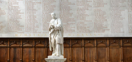 isaac newton: Statue of Isaac Newton in front of World War II Memorial Inside Trinity College Chapel, Cambridge University, England