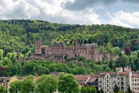 Heidelberg Castle in Lush Green Forested Hills Overlooking Quaint Town of Heidelberg, Baden-Wurttemberg, Germany photo