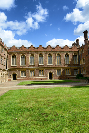 architectural exterior: Architectural Exterior of Third Court and Old Library on Sunny Day with Blue Sky, St Johns College, University of Cambridge, England